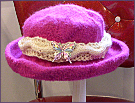 Diana's hat completed with cabled hatband and butterfly pin