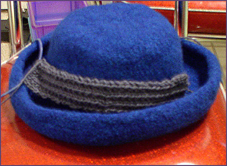 Felted hat with partially completed hat band