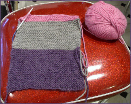 Striped knitted scarf purple gray and pink