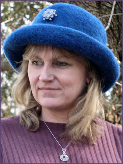 Diane, wearing teal blue hat