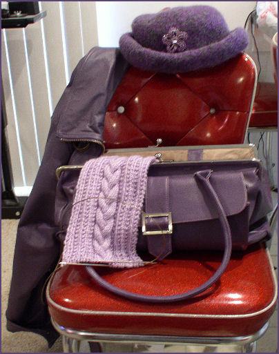 Purple purse, purple jacket, purple hat