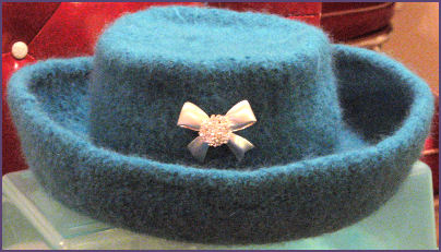 blue felted flat top hat with bowtie pin accent