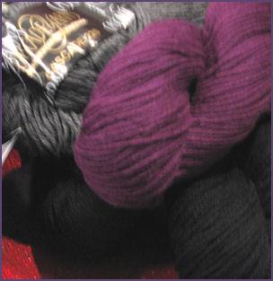 purple yarn, gray yarn, black yarn in hanks