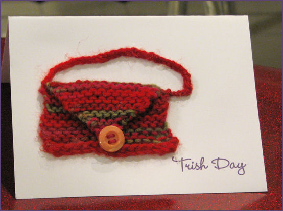 front of notecard with tiny knitted purse glued to front