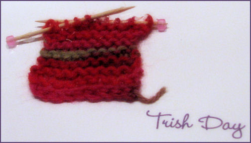front of card with small knitted square with toothpick knitting needles