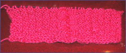 pink cabled square in progress
