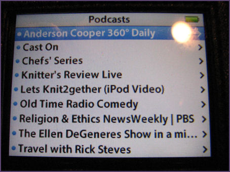 Closeup of podcast listings on iPod