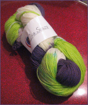 Hank of yarn in lime, white and dark purple