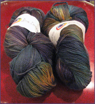 yarn in deep purples, greens and rust and such