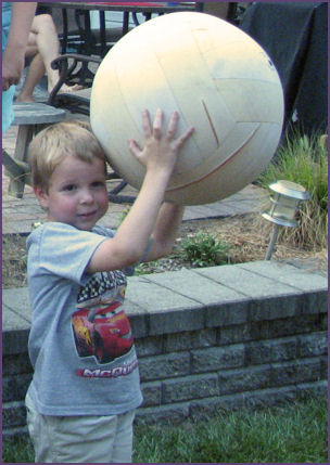 Steven holding large ball over his head