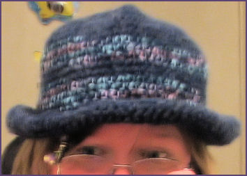 Blue crocheted hat with brim