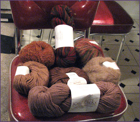 Pile of differently colored and textured brown yarns