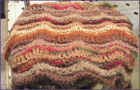 Multicolored brown ripple afghan in progress