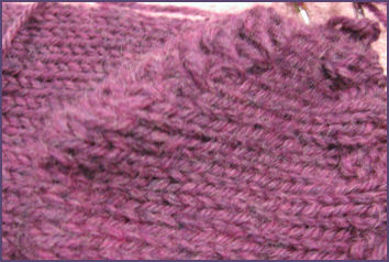 closeup of short row heel stitches
