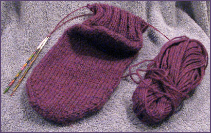 Second sock in progress with ball of yarn attached