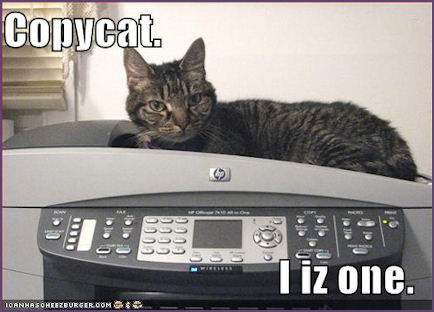 Cat, sitting on Printer, with caption, copycat, I is one.