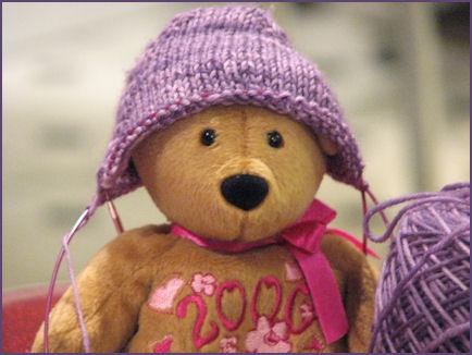 beanie baby bear wearing sock toe in progress as a hat