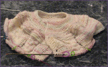 baby sweater with sleeve stitches on holders