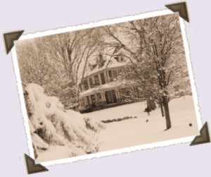 old photograph of farm house in the snow