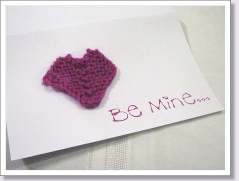 knitted heart on a greeting card
