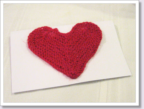 red knit heart on card