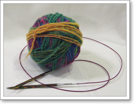 ball of multicolored wool with circular needle