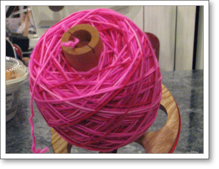 hot pink yarn on ball winder
