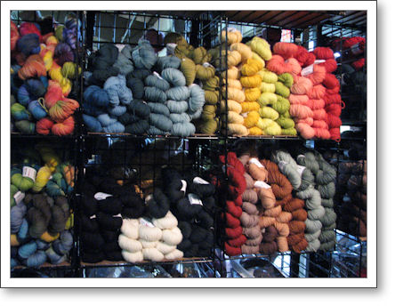 bags of colorful yarn on a shelf