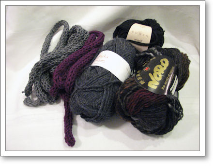 two i-cords next to balls of yarn