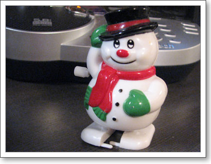 Wind up toy snow man