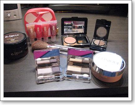 Eyeshadows, blush, foundation powder, and lip glosses