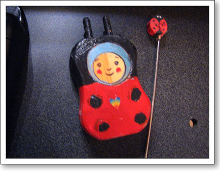 Hand-painted ladybug corder with two pegs