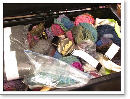 Storage ottoman, full of yarn