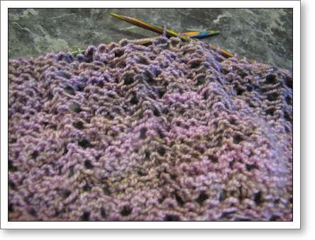 closeup of shawl in progress with knitting needles