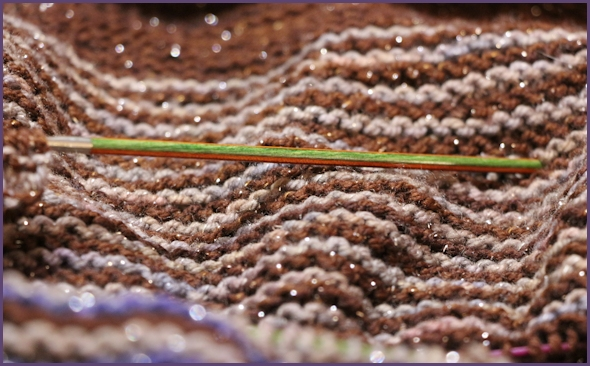 Closeup of brown, gray and blue striped shawl