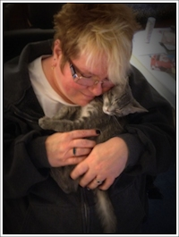 Photo of Trish holding kitten