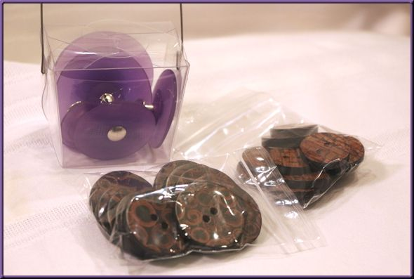 Purple pedestal buttons and a collection of cinnamon buttons