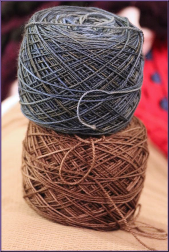 two yarn balls, one medium blue and one medium brown
