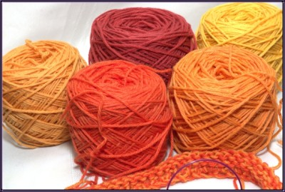 five shades of orange and yellow yarn