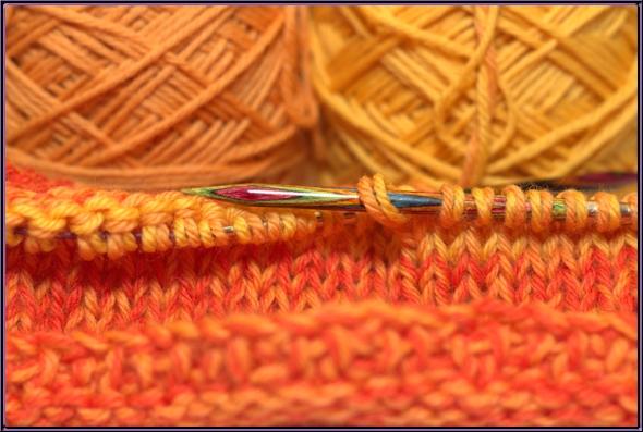 Photo of orange yarn taken with flash