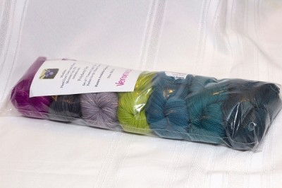 mini skeins of yarn in greens, blues and purples