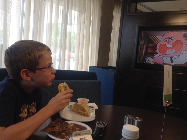 Steven eats breakfast while watching cartoons tableside