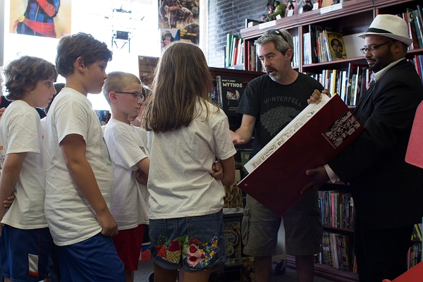 Group of campers visits the comic book store